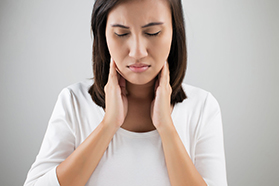 Woman with neck pain | Hormone Replacement Therapy for Hyperthyroidism